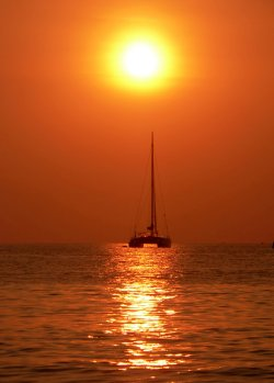 Sunset on a catamaran sailboat...